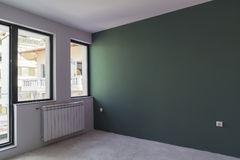 Unfinished interior of apartment  under construction. Dark Green Stock Image