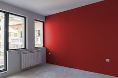 Unfinished interior of apartment  under construction. Wall paint Royalty Free Stock Photos