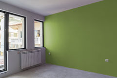 Unfinished interior of apartment  under construction. Wall paint Royalty Free Stock Photography