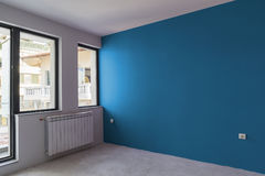 Unfinished interior of apartment  under construction. Wall paint Stock Photo