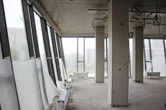 Unfinished interior of the business center with large windows Stock Images