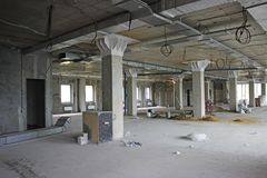 Unfinished interior of business center under construction in gre Stock Photo