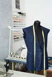Unfinished Jacket on mannequin in Tailoring Studio Royalty Free Stock Image