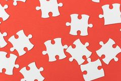 Unfinished jigsaw puzzle texture on red background. connection concept. idea concept.association concept. Background royalty free stock photography