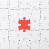 Unfinished jigsaw puzzle texture on red background. connection concept. idea concept.association concept. Background stock images