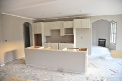 Unfinished kitchen in new home Stock Photos