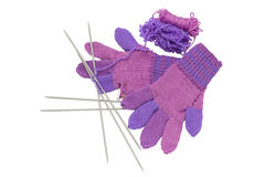 Unfinished knitted gloves with needles isolated on white Royalty Free Stock Image