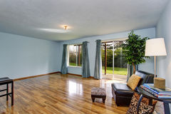 Unfinished living room interior with blue walls and blue curtains. Stock Photo