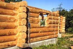 Unfinished log house Stock Images
