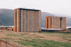Unfinished multi-story houses at mountain background stock photography