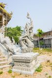 Unfinished naga statue beside the stairs in Thai temple Royalty Free Stock Photography