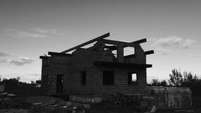An unfinished private house. Black and white timelapse. Construction of the new brick house stock video