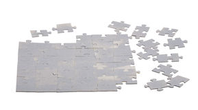 Unfinished puzzle from blank elements isolated on white Stock Images