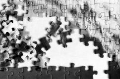 Unfinished puzzle detail background Stock Photo