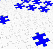 Unfinished Puzzle Showing Assembling And Completing. Unfinished Puzzle Showing Assembling, Completing And Finishing Stock Photo