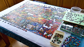 Unfinished puzzle on a table Stock Image