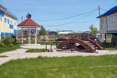 Unfinished recreation area with gazebo and bridge. SHARYPOVO, RF - May 28, 2017: The town Sharypovo is located in the Krasnoyarsk Territory of Russia Stock Images