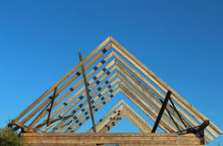 Unfinished roof of a wooden house. At a garden-plot Royalty Free Stock Images