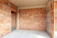 Free Unfinished Room Interior Of Building Under Construction. Brick Red Walls. New Home Royalty Free Stock Images - 163936499