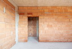 Free Unfinished Room Interior Of Building Under Construction. Brick Red Walls. New Home Stock Photography - 164194892