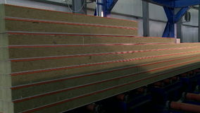 Unfinished sandwich panels moves on machine. Unfinished sandwich panels moves on automated machine stock video