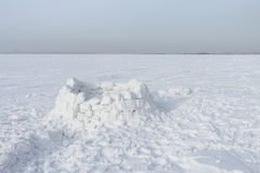 Unfinished snow construction of igloo Stock Photo