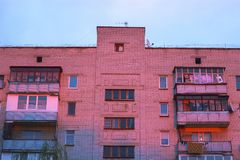 Unfinished Soviet building at sunset. Balconies and windows Royalty Free Stock Photography