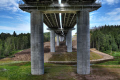 Unfinished steel road bridge on concrete pillars, crosses bed s Royalty Free Stock Photos