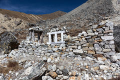 Unfinished Stone Building in high altitude Village in Nepal. Handmade unfinished Stone Building made off natural peaces without using cement according to royalty free stock photography
