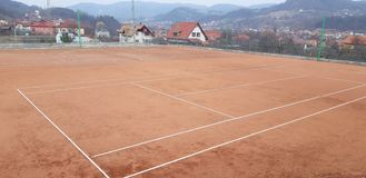 Unfinished tennis court stock photo