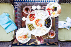 Unfinished Turkish breakfast on a patio table Stock Photos