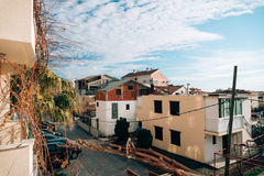 Unfinished two-storey house in Budva, Montenegro. Blue sky with. Clouds over houses Royalty Free Stock Photo
