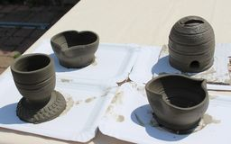 Unfinished pieces of pottery, which are not fired yet and stil grey stock photography
