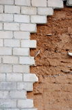 Unfinished wall of bricks and clay falling concept Royalty Free Stock Photos