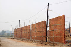 Unfinished wall in the construction site Stock Photos