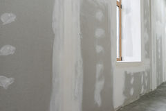 Unfinished wall with window in apartment Stock Images