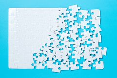 Jigsaw puzzle pieces on blue background Royalty Free Stock Photo
