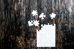 Unfinished white puzzle with missing pieces Stock Images
