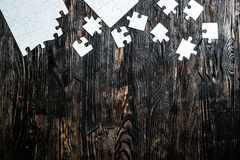 Unfinished white puzzle with missing pieces Stock Photo