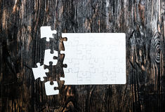 Unfinished white puzzle with missing pieces Stock Photography