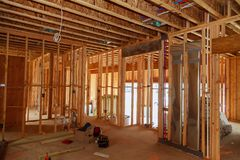 Unfinished wood frame building or a house. Under construction royalty free stock photo