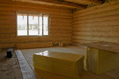 Is unfinished wood log cabin home.The interior Royalty Free Stock Photography