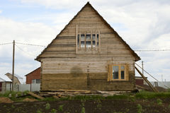 Unfinished wooden house with a backyard Royalty Free Stock Photos