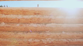 Unfinished wooden house wall in the sun. Unfinished wooden house wall in the sun. Canadian angle masonry. Canadian style stock video footage
