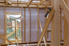 Unfinished wooden rail of frame house. Unfinished wooden rail of a frame house stock image