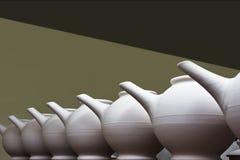 Unfired Clay Teapots en fila Fotos de archivo