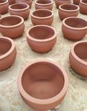 Unfished clay pots wait for burning process in pottery factory. Royalty Free Stock Photography