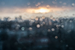 Unfocuced sun. And water drops on the window Stock Photography