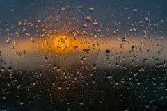 Unfocuced sun. And water drops on the window Stock Photo