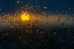 Unfocuced sun. And water drops on the window Royalty Free Stock Images